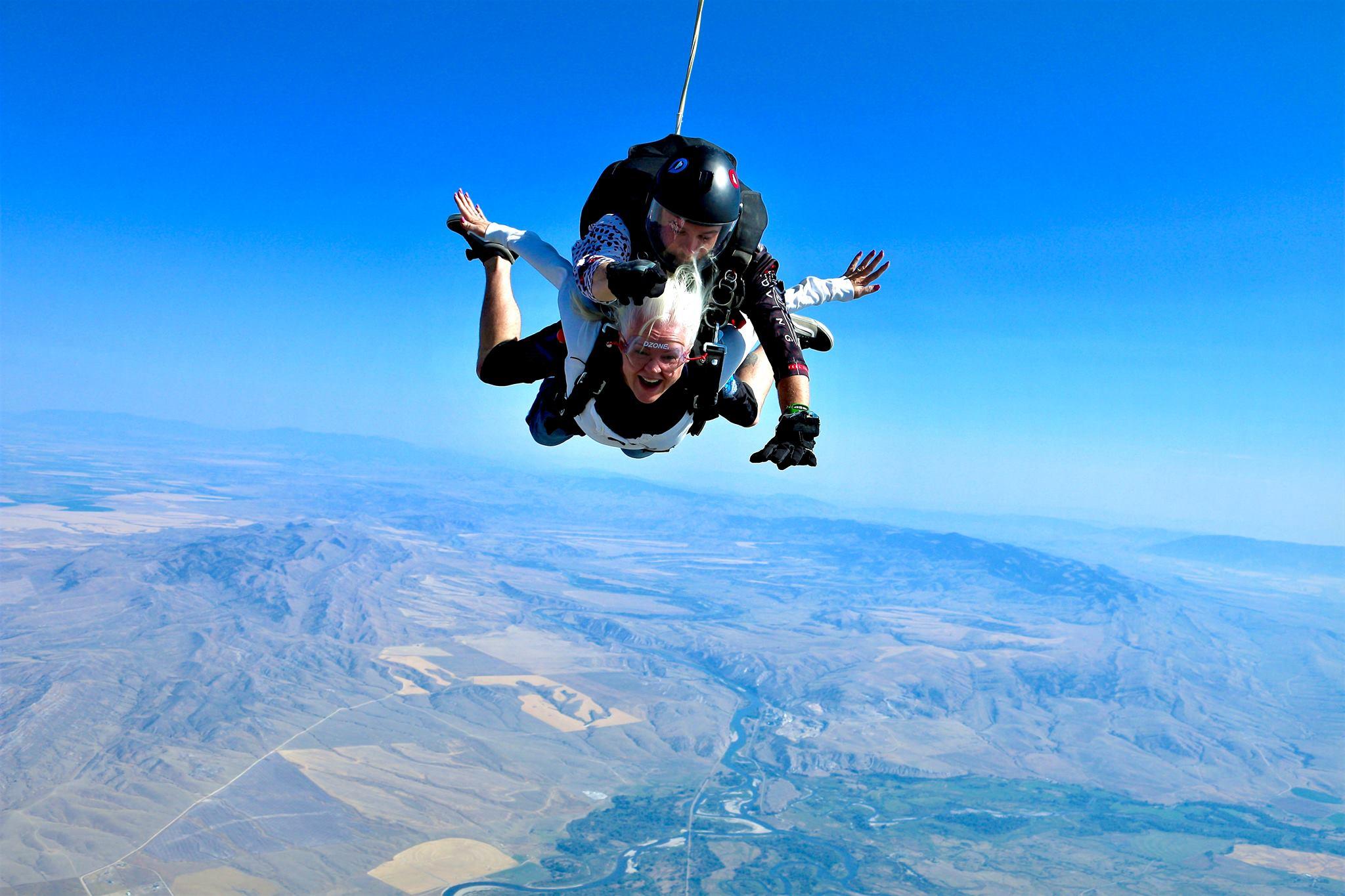 Female tandem skydiving - DZONE® Skydiving