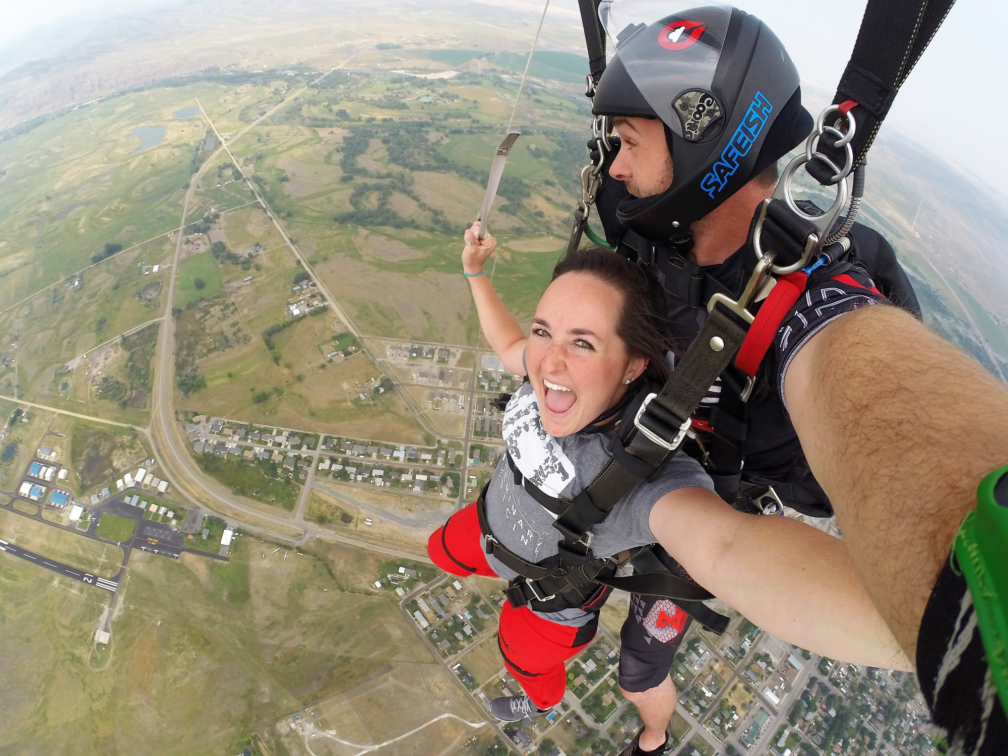 Woman tandem skydiving - DZONE® Skydiving
